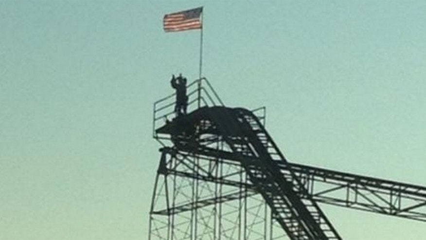 This photo shows suspect Christopher Angelo on top of  Jet Star Roller Coaster.