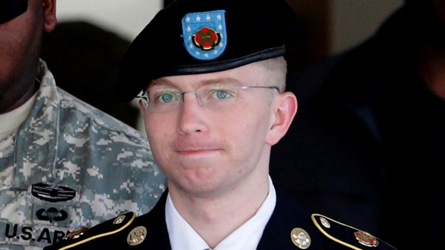 FILE 2012: Army Pfc. Bradley Manning is escorted out of a courthouse in Fort Meade, Md.