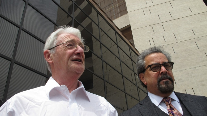 FILE  - In this April 25, 2012 file photo, British businessman Christopher Tappin, left, leaves federal court with one of his lawyers, Kent Schaffer, in El Paso, Texas. A U.S. judge on Wednesday, Jan. 9, 2013 is expected to sentence the 65-year-old Tappin, who pleaded guilty in November to trying to buy missile parts and resell them to Iran. (AP Photo/Juan Carlos Llorca, File)