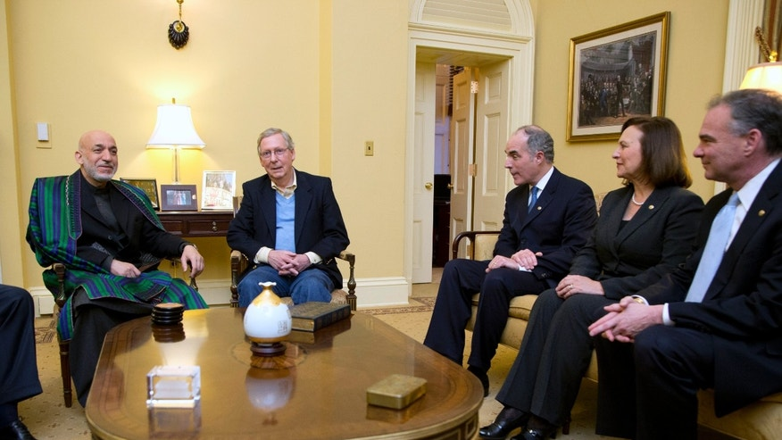 Afghanistan President Hamid Karzai, from left, meets Senate Republican Leader Sen. Mitch McConnell, R-Ky., Sens. Bob Casey, D-Pa., Deb Fischer, R-Neb., and Tim Kaine, D-Va., on Capitol Hill in Washington, Wednesday, Jan. 9, 2013. (AP Photo/Manuel Balce Ceneta)