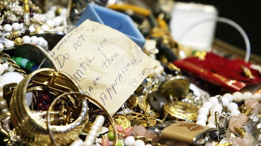 This Jan. 2, 2013 photo shows a pile of primarily costume jewelry among the mass of seized stolen goods during a news conference at Hudson Falls Village Court in Hudson Falls, N.Y. Few clues exist pointing to the owners of the roughly 30,000 items discovered after 39-year-old burglary suspect John Suddard's recent arrest. So police are taking the novel step of displaying the items at the local high school Wednesday night, Jan. 9, 2013. (AP Photo/The Post-Star, Derek Pruitt)