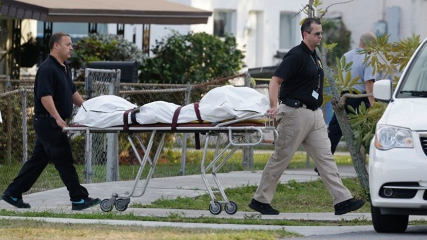 Jan. 11, 2013: Personnel from the Broward County, Fla., medical examniners office remove what are believed to be human remains that were found in the former backyard of a couple whose baby hasn't been seen in more than a year.