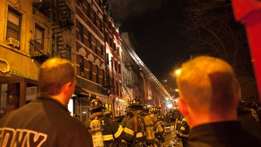 January 10, 2013: Fire crew tend to a fire in a residential complex at 41 spring street in New York.