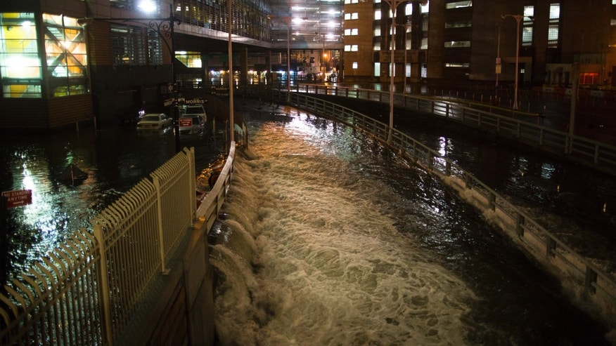 Oct. 29, 2012: In this file photo, sea water floods the entrance to the Brooklyn Battery Tunnel in New York during Superstorm Sandy.