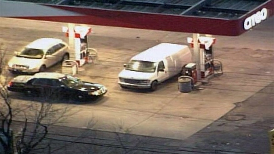 Detroit police searched this white van Tuesday to discover an empty casket in the back.