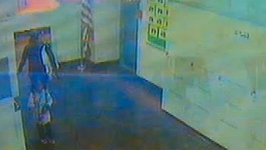 Jan. 14, 2013: Surveillance video released by police shows the Nailla Robinson and her abductor.
