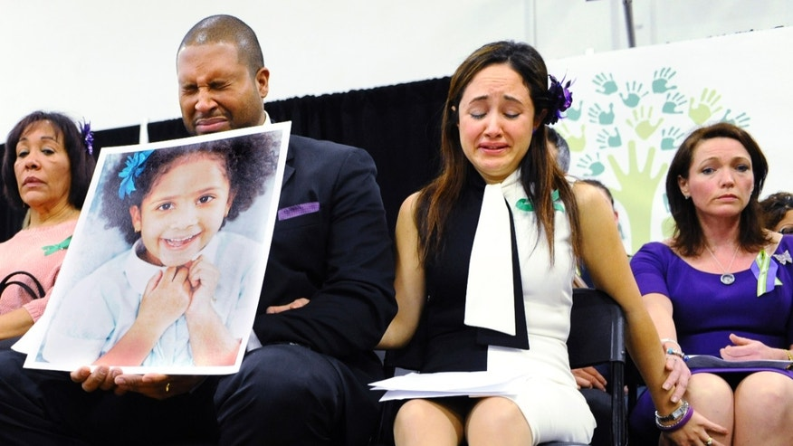 Jan. 14, 2013: Jimmy Greene, foreground left, Nelba Marquez-Greene, center, parents of Sandy Hook Elementary School shooting victim Ana Marquez-Greene, and Nicole Hockley, right, mother of victim Dylan Hockley, react during a news conference at Edmond Town Hall in Newtown, Conn.