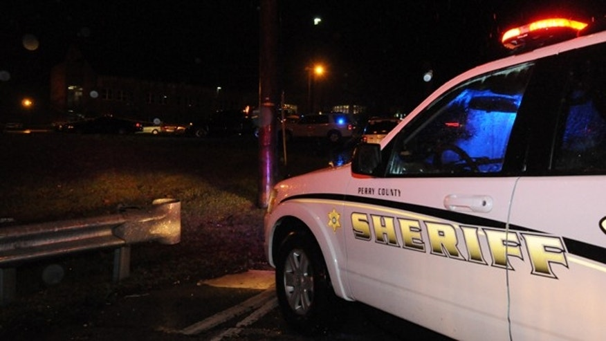 Jan. 15, 2012: Members of the Perry County Sheriff Office respond to the scene at Hazard Community College on Tuesday night.