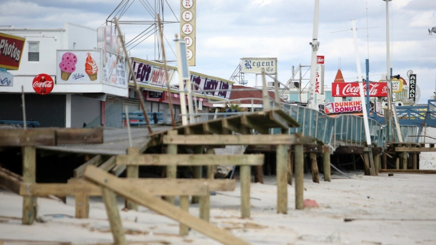 Oct. 31, 2012: File photo, the Seaside Heights boardwalk is heavily damaged after Superstorm Sandy moved through the area.