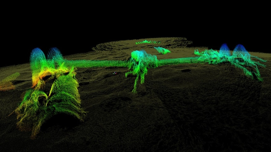 This 2012 high-resolution 3-D sonar image provided by the National Oceanic and Atmospheric Administration shows the remains of the USS Hatteras, the only U.S. Navy ship sunk in combat in the Gulf of Mexico during the Civil War. The view is from the vessels port side, toward its stern. The long paddlewheel shaft, bent and angled, rests on the seabed with the fragmented remains of the port side paddlewheel on the right. (AP Photo/NOAA, Northwest Hydro Inc., James Glaeser)