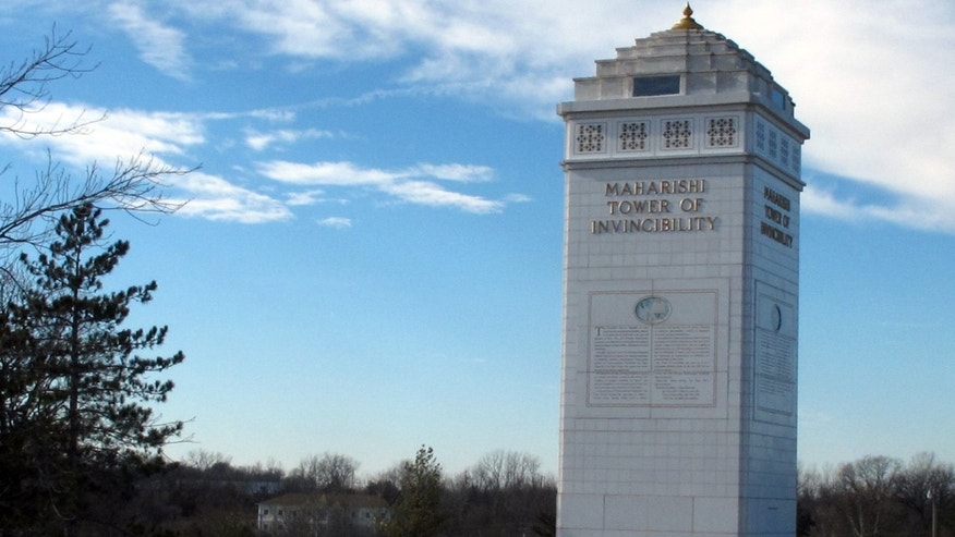 In this Friday, Jan. 18, 2013 photo, the Maharishi Tower of Invincibility, honoring the late Maharishi Mahesh Yogi, who is credited with spreading transcendental meditation, stands in Fairfield, Iowa. The Maharishi Foundation has filed a lawsuit seeking to enforce its trademark rights against a supporter of a rival technique called vedic meditation. (AP Photo/Ryan J. Foley)