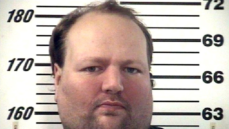 This December 2012 handout photo provided by the Effingham County Sheriff's Office shows Chad Moretz. A SWAT team sniper shot 34-year-old Moretz on Jan. 11, 2013, ending a four-hour standoff when Moretz emerged from his Effingham County home armed with an assault rifle. (AP Photo/Courtesy of the Effingham County Sheriff's Office)