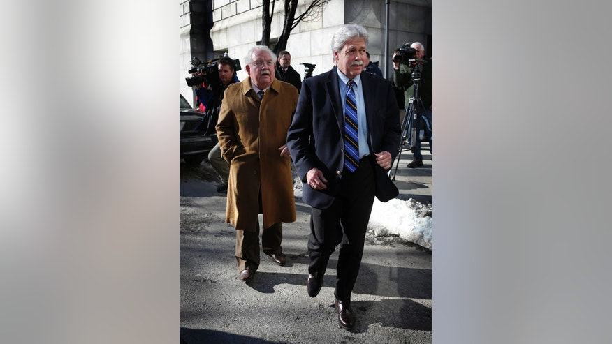 Mark Strong Sr., right, and his attorney, Dan Lilley, leave the Cumberland County Court House, Friday, Jan. 18, 2013, in Portland, Maine. No plea was reached Friday and the case will proceed to trial next week for Strong, the business partner of a Zumba dance instructor charged with running a prostitution business from her Kennebunk, Maine studio. Justice Nancy Mills declined to let the defense lawyer remove himself from representing Strong.(AP Photo/Robert F. Bukaty)