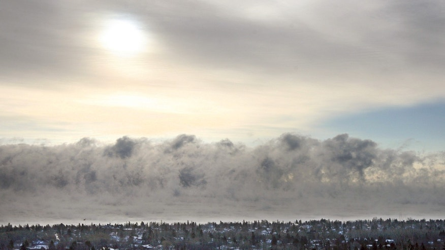 Fog forms over Lake Superior on Monday, Jan. 21, 2013, along the Duluth, Mich. shoreline as the area experiences subzero temperatures. (AP Photo/The Duluth News-Tribune, Bob King)