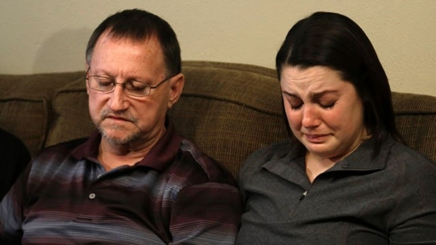 Jan. 22, 2013: Mike Lovelady, left, sits with his niece Erin Lovelady as she cries and talks about her father Victor Lovelady.