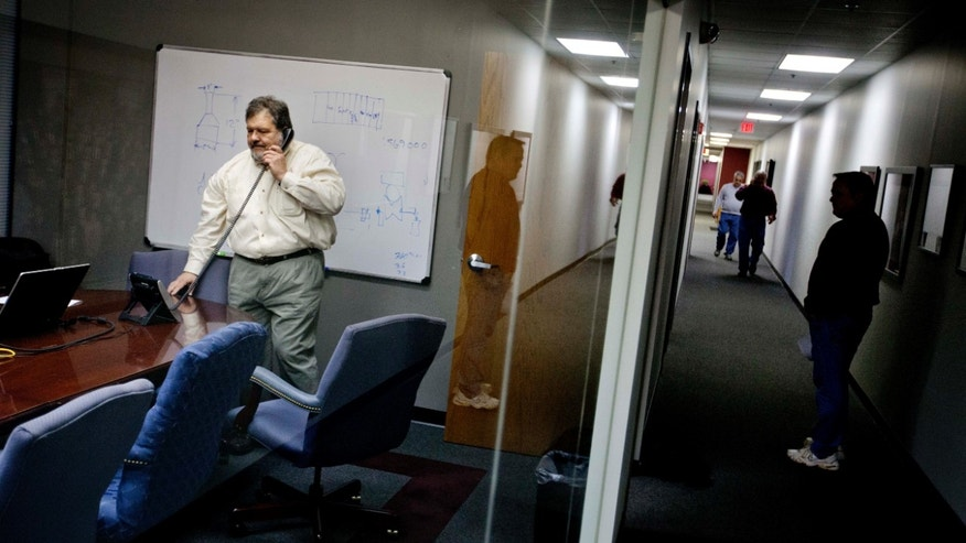 In this Jan. 15, 2013, photo, Rosser Pryor, Co-owner and President of Factory Automation Systems, takes a phone call at the company's Atlanta facility. Pryor, who cut 40 of 100 workers since the recession, says while the company is making more money now and could hire ten people, it is holding back in favor of investing in automation and software. (AP Photo/David Goldman)