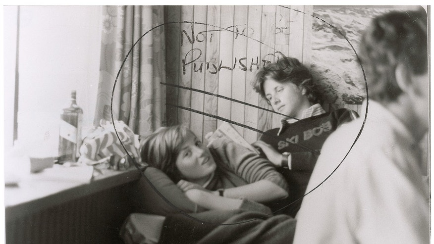 "Jan. 24, 2013: This image provided by RR Auction shows a photograph marked ""not to be published"" of a teenage Diana Spencer before she became Princess of Wales, with a young friend seated beside her."