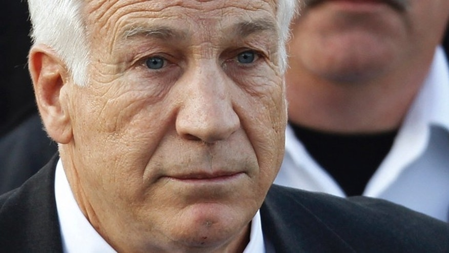 Dec. 13, 2011: In this file photo,Jerry Sandusky, the former Penn State assistant football coach charged with sexually abusing boys, leaves the Centre County Courthouse in Bellefonte, Pa.