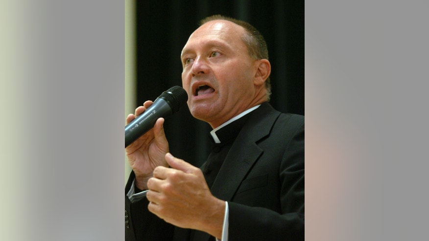 In this May 4, 2006 photo, Monsignor Kevin Wallin speaks at the Catholic Center, headquarters of the Diocese of Bridgeport, in Bridgeport, Conn.