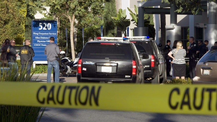 Jan. 28, 2013: Police investigate as medical personnel exit the scene outside a medical office near Hoag Hospital where shots were fired in Newport Beach, Calif.