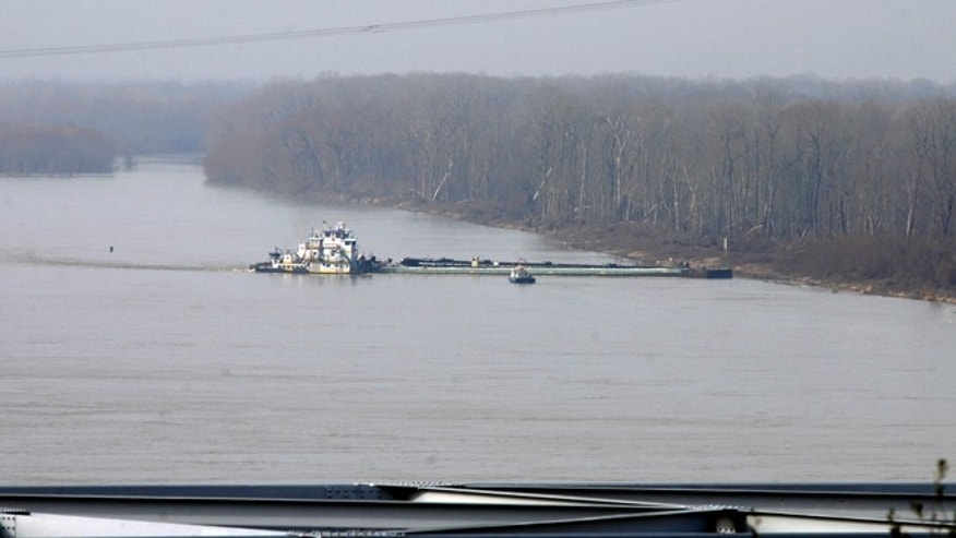 Jan 27: The towboat Nature Way Endeavor banks a barge against the western bank of the Mississippi River Sunday near Vicksburg, Miss.