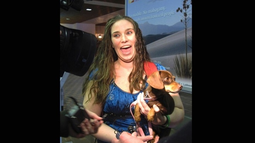 Jan. 30, 2013: Mandi Smith, of Fort Campbell, Ky., is reunited with her dog, Pooka at the Albuquerque International Sunport Airport in Albuquerque, N.M.