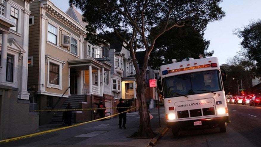 Jan. 29, 2013: San Francisco Police park a mobile command vehicle in front of a home on the 1100 block of Masonic Avenue.