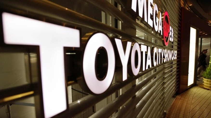 Dec. 27, 2012: A man walks out from a Toyota showroom in Tokyo.