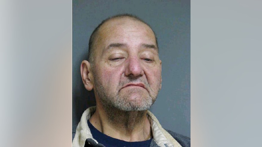 In this booking photo released by Vermont State Police, 52-year-old Mark Mumley,  of Alburgh, Vt. is shown. Police say more than $200,000 in gold coins were stolen from a vacant home after its eccentric owner died in a farm accident last year. Authorities say four suspects also stole a vehicle, antiques and other items from the home in Alburgh in the months after its owner's death. Mumley, Ricky Benjamin, 35, and 41-year-old Shawn Farrell, of Swanton, were arraigned and held on $75,000 bail.  (AP Photo/Vermont State Police)