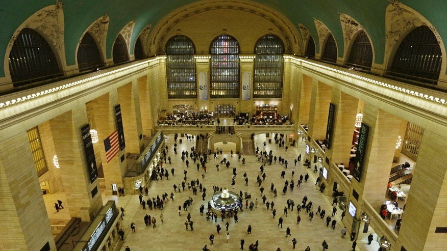 Jan. 9, 2013: Travelers cross the main concourse of Grand Central Terminal in New York, as seen from a bird's eye view through a window near the ceiling.