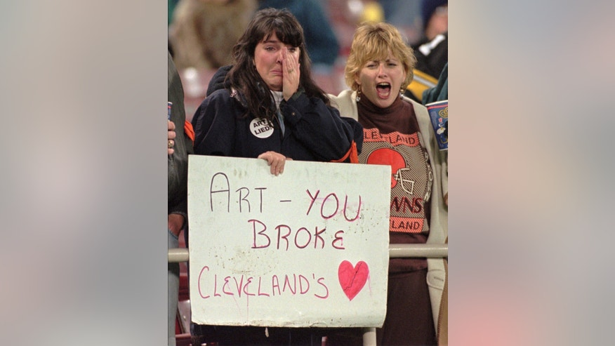 FILE - In this Nov. 13, 1995, file photo, Cleveland Browns fan Lisa Vann, left, cries as her friend Jeanne Jolluck yells as the Browns lose to the Pittsburgh Steelers, 20-3, in an NFL football game in Pittsburgh. Modell was among the most important figures in the NFL as owner of the Cleveland Browns, who became the Ravens after he took the team to Baltimore in 1996. Cleveland fans hope Modell, who died in 1012, is not voted into the Pro Football Hall of Fame on Saturday when a committee choses this year's class from a list of 15 finalists that includes coach Bill Parcells, former 49ers owner Ed DeBartolo Jr., single-season sacks leader Michael Strahan and Ravens tackle Jonathan Ogden.(AP Photo/Gene Puskar, File)