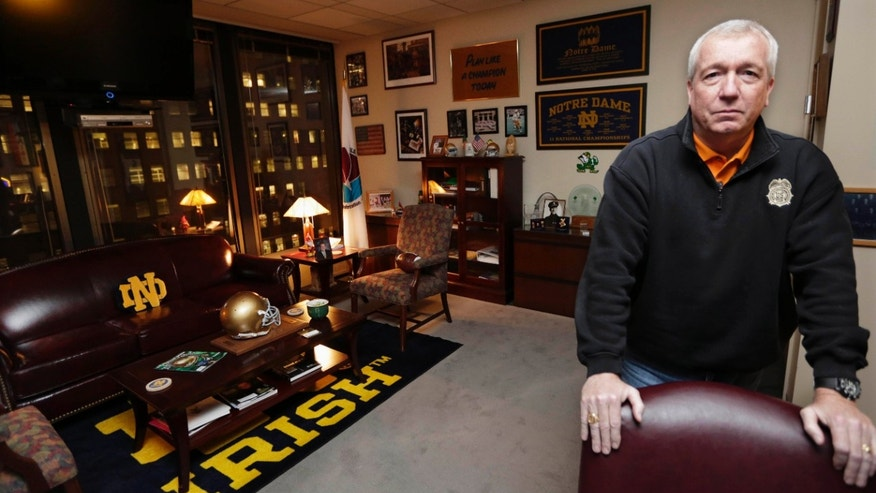 In this Tuesday, Dec. 11, 2012 photo, Jack Riley, head of the Drug Enforcement Administration in Chicago, stands in his downtown office. A first-of-its-kind drug enforcement headquarters has opened in Chicago where 70 federal agents, local police and prosecutors work side-by-side, all year round to fight drug trafficking - a set-up meant to end inter-agency rivalry and miscommunication that can plague investigations. The opening of the Chicago Strike Force office comes as Mexican traffickers have taken control of more than 90 percent of the drugs market in Chicago, which the syndicates also use as a hub for distribution across the Midwest, the DEA says. (AP Photo/M. Spencer Green)