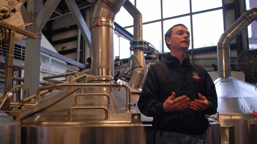 Jan 23, 2013: Brandon Smith, the Alaskan Brewing Co.'s brewing operations and engineering manager, speaks to reporters about the company's new boiler system.