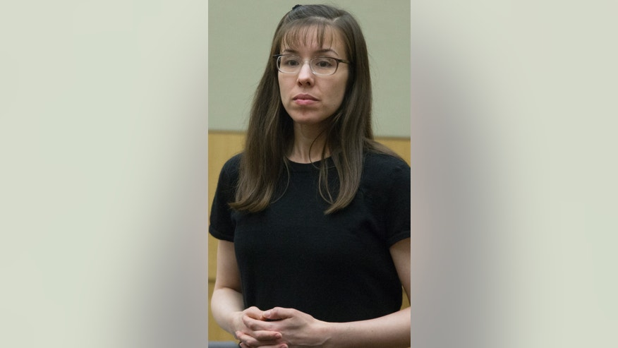 Defendant Jodi Arias stands while the jury enters the courtroom in her murder trial in Judge Sherry Stephens' Superior Court, on Monday, Feb 4, 2013. Arias stands trial accused of murdering her lover, Travis Alexander, in his Mesa home in 2008. (AP Photo/The Arizona Republic, Mark Henle)
