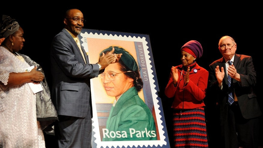 Feb. 4, 2013 - Councilwoman Joann Watson, Lloyd Wesley, Jr., Detroit postmaster,  Elaine Eason Steele, co-founder of  Rosa & Raymond Parks Institute, and Sen. Carl Levin at the unveiling of the Rosa Parks 100th birthday commemorative postage stamp at the Museum of African American History in Detroit.