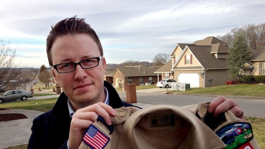 In this Monday, Feb. 4, 2013 photo provided by the family, Wes Comer holds the Boy Scout uniform of his son, Isaiah, outside their home in Knoxville, Tenn. Comer, his wife and children belong to an Apostolic Pentecostal church that considers homosexuality sinful. Comer says he will pull his eldest son out of the Scouts, despite a positive experience with them, if the BSA modifies the policy to allow some troops to accept gays. (AP Photo/Brooke Comer)