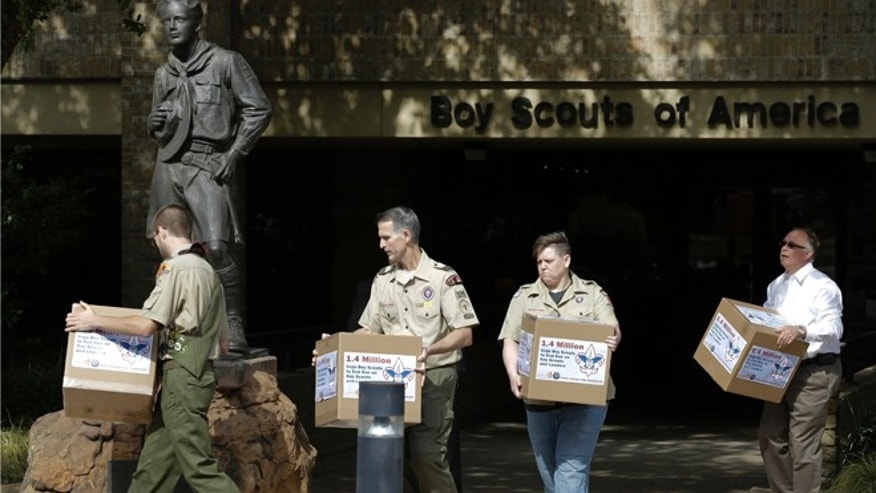 Feb. 4, 2013: In this photo Eagle Scout Will Oliver, from left, former Scoutmaster Greg Bourke, former den leader Jennifer Tyrrell and Eric Andresen, right, a parent of a gay scout deliver boxes filled with a petition to the statue in front of the Boy Scouts of America headquarters in Irving, Texas.
