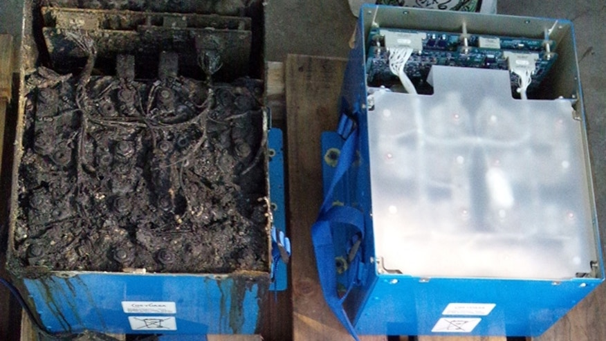 Jan. 17, 2013: This photo provided by the Japan Transport Safety Board shows the distorted main lithium-ion battery, left, and an undamaged auxiliary battery of the All Nippon Airways' Boeing 787.