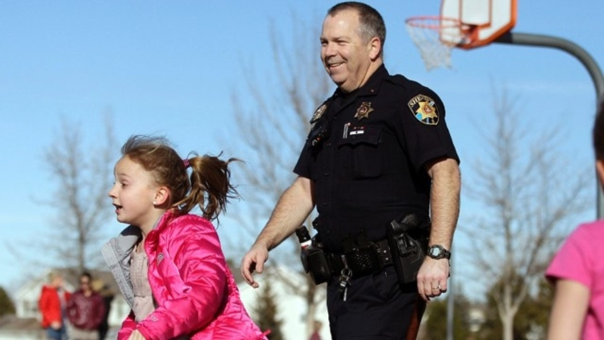 Jan. 31, 2013: Douglas County Sheriff Department Lt. Brian Murphy spends some time on the playground with kids during recess at Buffalo Ridge Elementary School.
