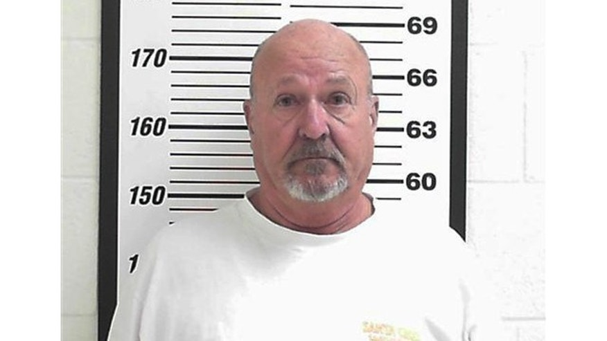 FILE: This photo shows Clare Niederhauser, 64, a Layton, Utah homeowner arrested on suspicion two counts of reckless endangerment.