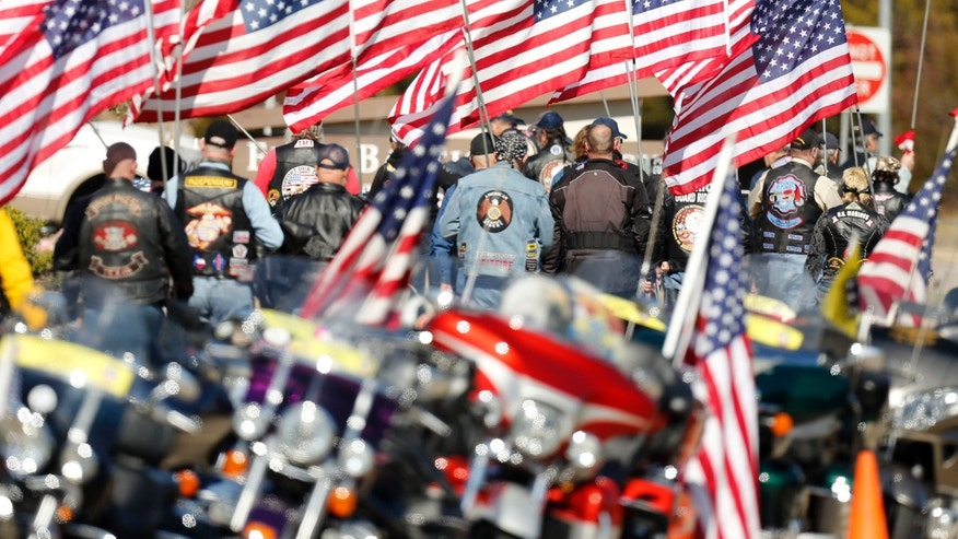 Patriot Gurard Riders prepare to form a procession for Chad Littlefield, during his funeral at the First Baptist Church of Midlothian, Texas on Friday, Feb. 8, 2013. Littlefield and ex-Navy SEAL sniper Chris Kyle were allegedly slain by ex-Marine Eddie Ray Routh at a gun range on Feb. 2. (AP Photo/The Dallas Morning News, Michael Ainsworth)  MANDATORY CREDIT; MAGS OUT; TV OUT; INTERNET OUT; AP MEMBERS ONLY