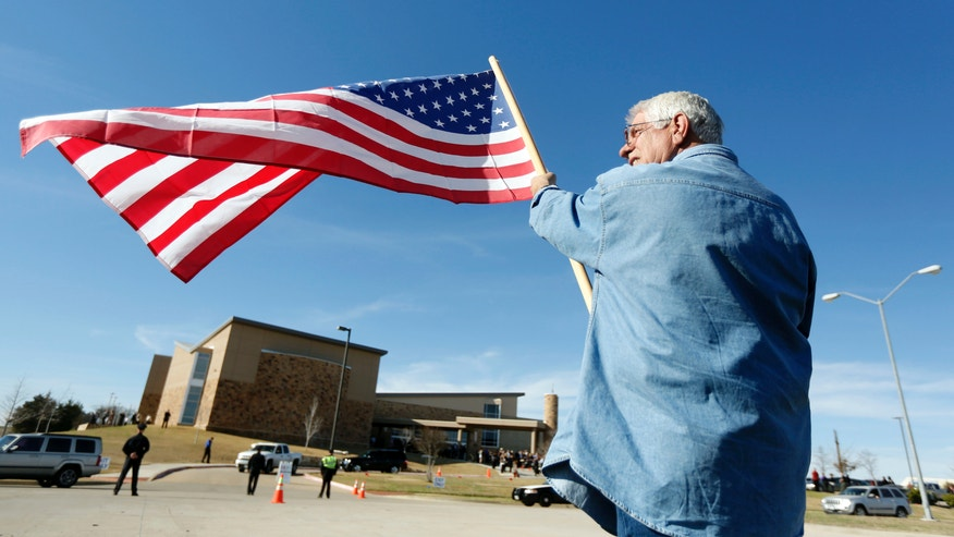 Les Clemons, of Red Oak, shows his respect for Chad Littlefield, during his funeral at the First Baptist Church of Midlothian, Texas on Friday, Feb. 8, 2013. Littlefield and ex-Navy SEAL sniper Chris Kyle were allegedly slain by ex-Marine Eddie Ray Routh at a gun range on Feb. 2. (AP Photo/The Dallas Morning News, Michael Ainsworth)  MANDATORY CREDIT; MAGS OUT; TV OUT; INTERNET OUT; AP MEMBERS ONLY