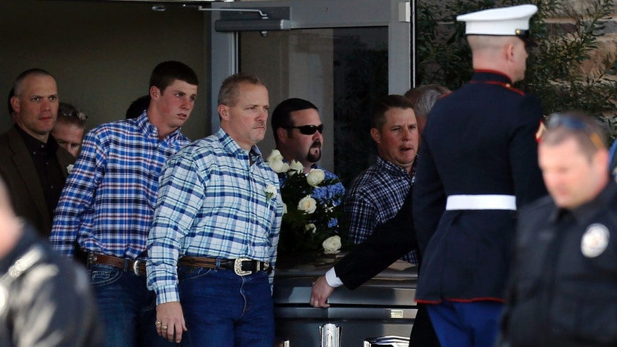 Pallbearers carry the casket of  Chad Littlefield during his funeral at the First Baptist Church of Midlothian, Texas on Friday, Feb. 8, 2013. Littlefield and ex-Navy SEAL sniper Chris Kyle were allegedly slain by ex-Marine Eddie Ray Routh at a gun range on Feb. 2. (AP Photo/The Dallas Morning News, Michael Ainsworth)  MANDATORY CREDIT; MAGS OUT; TV OUT; INTERNET OUT; AP MEMBERS ONLY