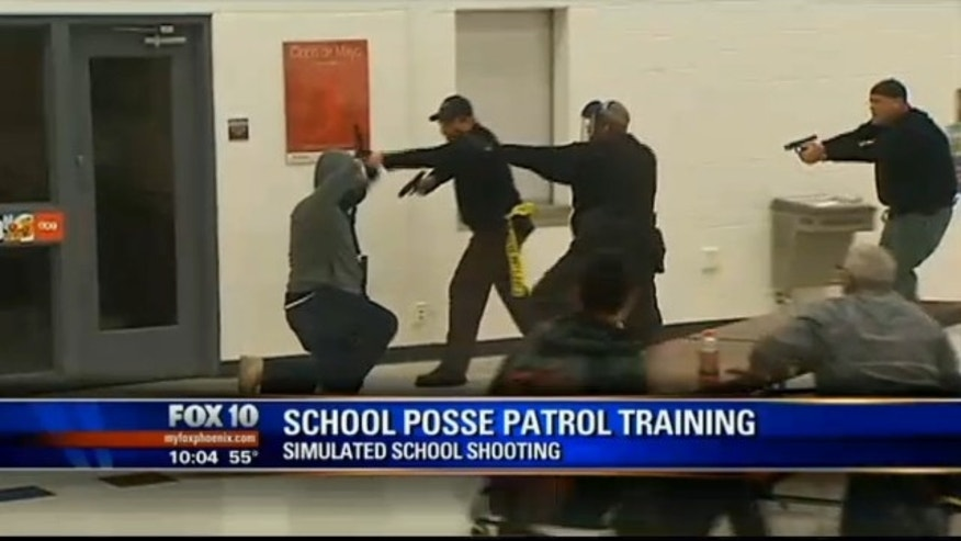 Members of the Maricopa County Sheriff's SWAT team stimulate a school shooting at a Phoenix-area school.