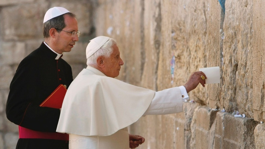 FILE - In this Tuesday, May 12, 2009 file photo, Pope Benedict XVI places a note in the Western Wall, Judaism's holiest site, in Jerusalem's Old City. Benedict announced Monday Feb. 11, 2013 he would  resign Feb. 28, the first pontiff to do so in nearly 600 years.(AP Photo/David Silverman, Pool)