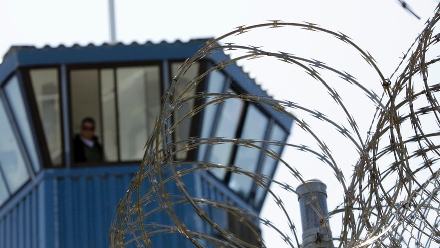 Concertina wire and a guard tower are seen at Pelican Bay State Prison near Crescent City, Calif.