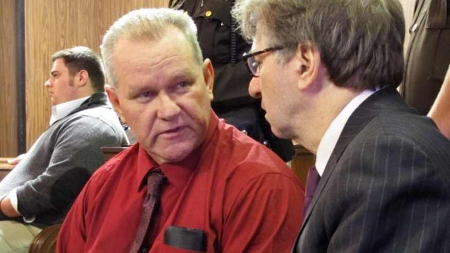 Feb. 11, 2013: Randolph Arledge, left, speaks to one of his attorneys, Innocence Project co-director Barry Scheck, before a court hearing in Corsicana, Texas.