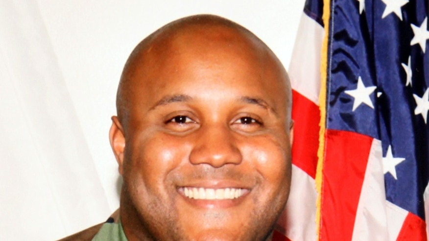 This undated photo released by the Los Angeles Police Department shows suspect Christopher Dorner, a former Los Angeles officer who killed himself on Feb. 12 after killing four people, including three police officers -- nearly 10 percent of all law enforcement officers killed by gunfire last year. (AP/Los Angeles Police Department)