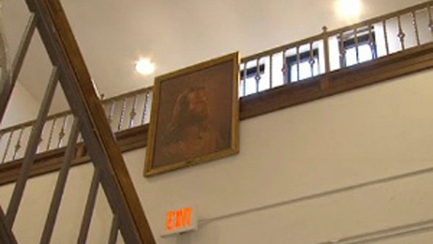 Feb. 7, 2013: Photo of a portrait of Jesus hangs in the hallway at Jackson Middle School  in Jackson, Ohio.
