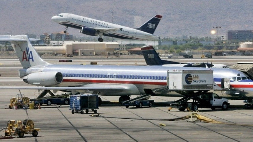 An American Airlines and a US Airways plane.